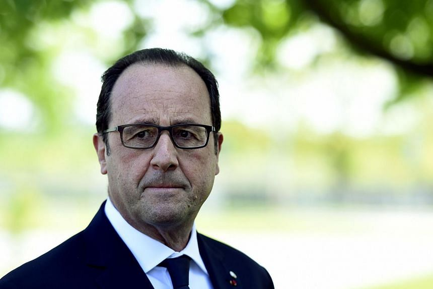 French President Francois Hollande is pictured during a press conference, on the second day of the fourth European Union (EU) eastern Partnership Summit in Riga, on May 22, 2015. New questions surfaced about his personal security on Tuesday as Le Mon
