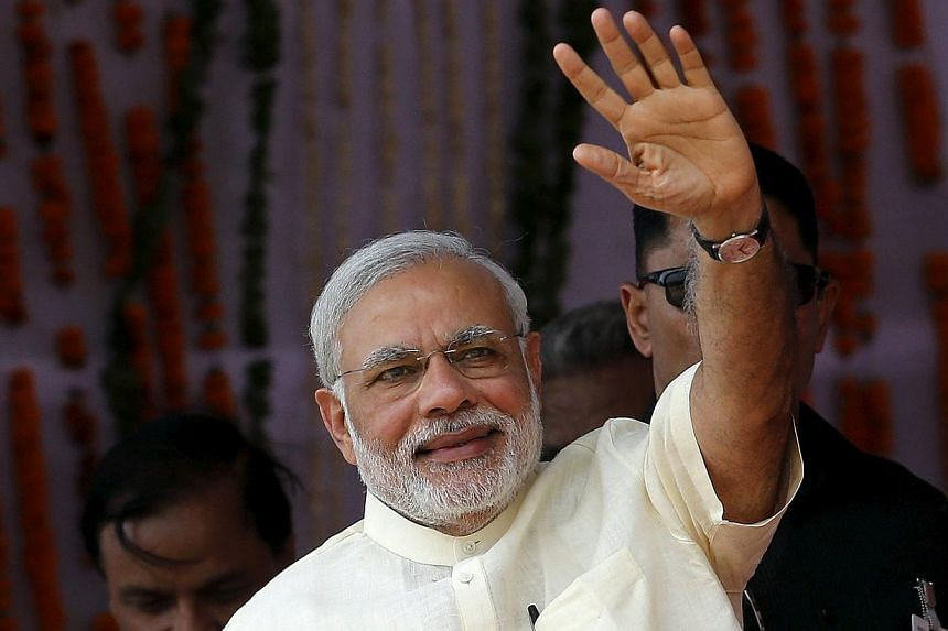 India's Prime Minister Narendra Modi waves towards his supporters during a rally in Mathura, India on May 25, 2015. -- PHOTO: REUTERS