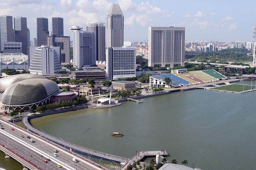 In the next five years, Singapore's economy is expected to grow by 2 per cent to 4 per cent per annum on average, the Ministry of Trade and Industry (MTI) said on Tuesday. -- ST PHOTO:DANIEL NEO