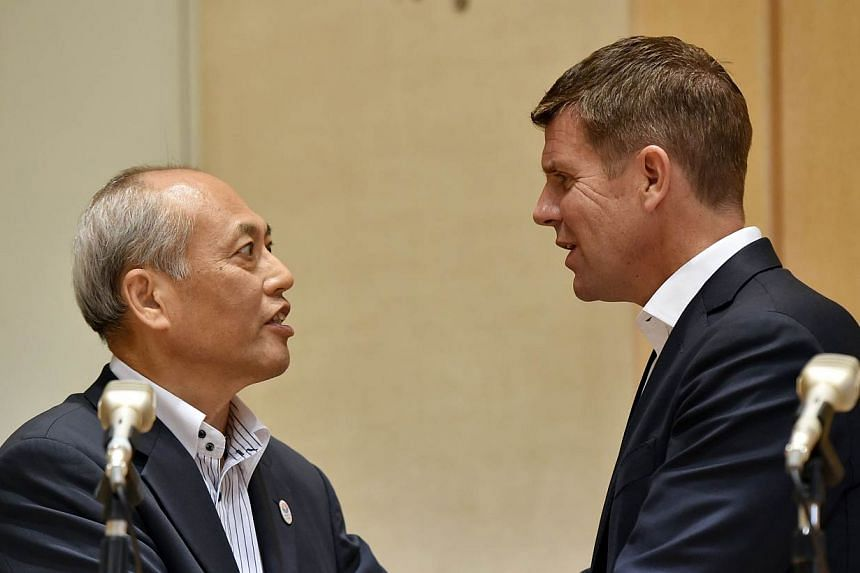 Australia's New South Wales state premier Mike Baird (Right) shakes hands with Tokyo Governor Yoichi Masuzoe (Left) after exchanging an agreement for cooperation regarding the Tokyo 2020 Olympic Games at the Tokyo city hall on May 19, 2015. On Tuesda