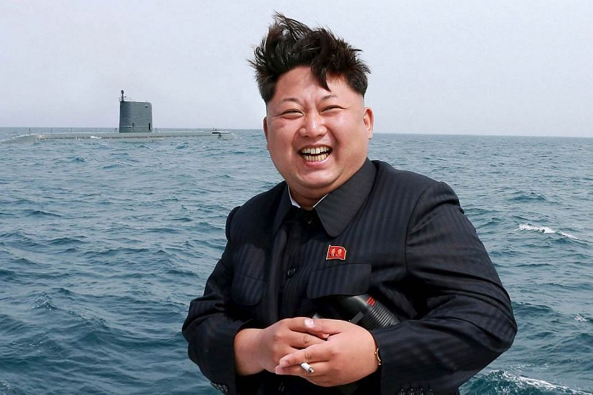 North Korean leader Kim Jong Un watches the test-fire of a strategic submarine underwater ballistic missile (not pictured), in this undated photo released by North Korea's Korean Central News Agency (KCNA) in Pyongyang on May 9, 2015. Kim has hailed