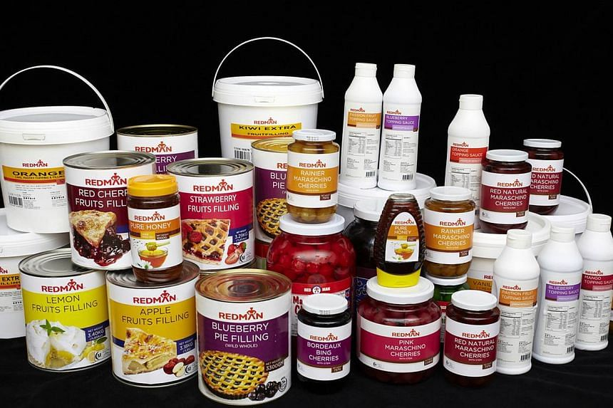 """Phoon Huat, led by Managing Director Wong Chen Liong, provides baking ingredients under brands including """"Red Man"""" to restaurants and hotels. --ST FILE"""