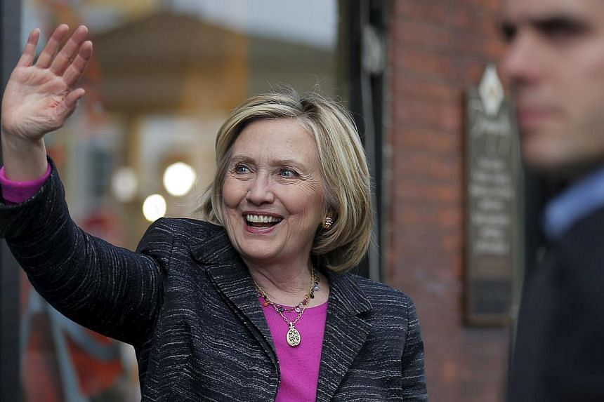 Democratic presidential candidate Hillary Clinton waves to supporters gathered outside after she spoke at the Water Street Bookstore in Exeter, New Hampshire May 22, 2015. -- PHOTO: REUTERS
