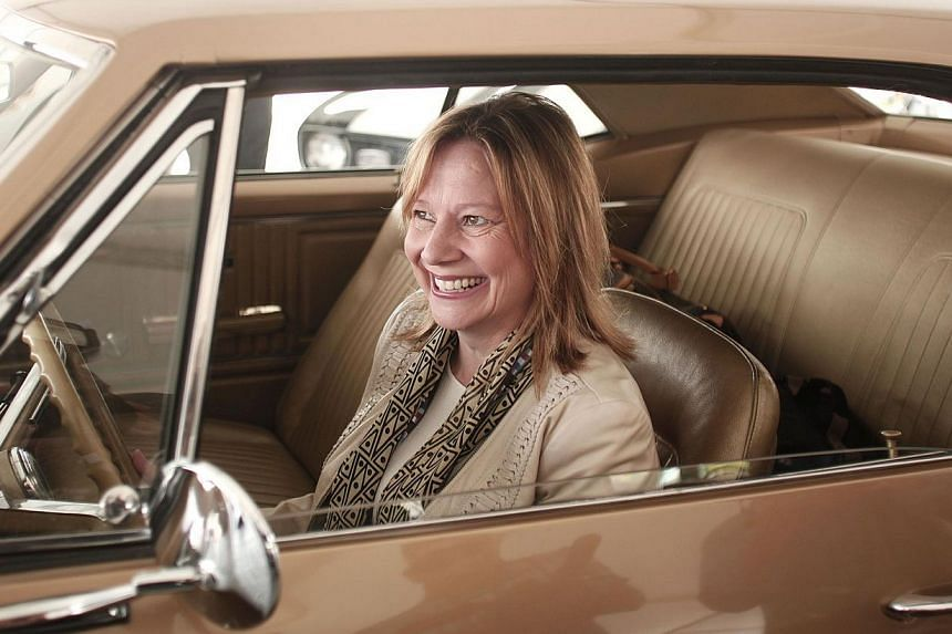 General Motors CEO Mary Barra sitting in the first Camaro ever built at a Camaro Museum on Detroit's Belle Isle on May 16, 2015. -- PHOTO: AFP