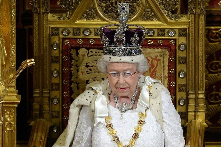 In this file photograph taken on June 4, 2014, Britain's Queen Elizabeth delivers the Queen's Speech from the Throne in the House of Lords during the State Opening of Parliament at the Palace of Westminster in London. -- PHOTO: AFP