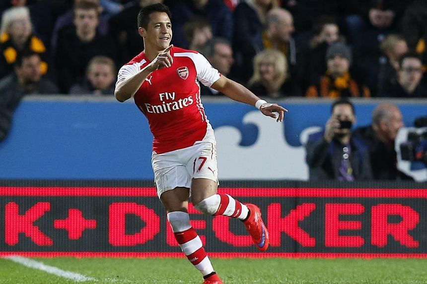 Alexis Sanchez celebrates after scoring the first goal for Arsenal. Sanchez was on Tuesday announced as the Professional Footballers' Association (PFA) Fans' Player of the Year after an excellent first season in English football. -- PHOTO: REUTERS&nb