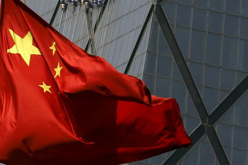 """China's top economic planner said on Wednesday that it would ease restrictions on corporate bond issues to encourage """"high-quality"""" companies to issue more bonds to support the economy. -- PHOTO: REUTERS"""