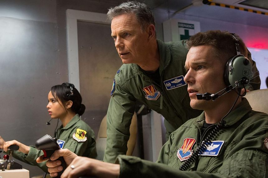 Ethan Hawke (left) as the former combat pilot who now conducts drone strikes from a safe and remote location. Also starring Zoe Kravitz (far left) and Bruce Greenwood (centre).
