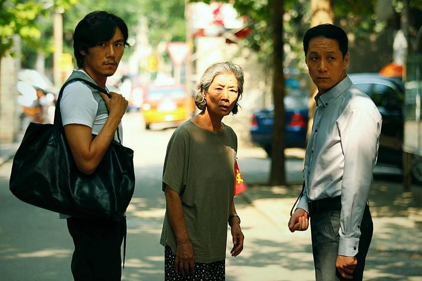 Lv Zhong as the prickly mother with her sons Qin Hao (left) and Feng Yuanzheng (right). -- PHOTO: GOLDENVILLAGE