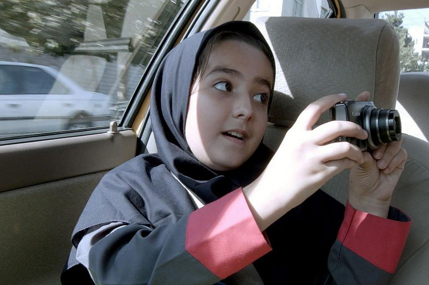 A precocious Hana Saedi, the director's own niece, is the highlight among the passengers in Taxi Tehran, who recites the regime-approved tenets for good film-making in the movie. -- PHOTO: THE PROJECTOR