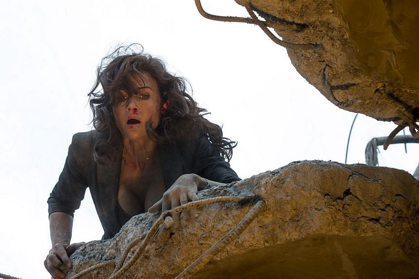 Carla Gugino (above) and Dwayne Johnson are hit with one calamity after another in San Andreas.