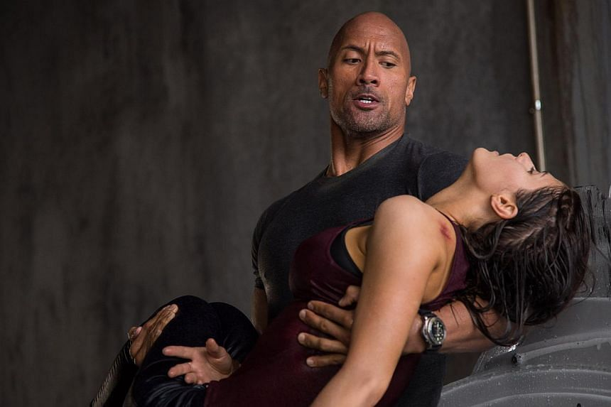 Dwayne Johnson plays a rescue pilot who attempts to save his ex-wife and daughter when earthquakes hit. -- PHOTOS: GOLDEN VILLAGE