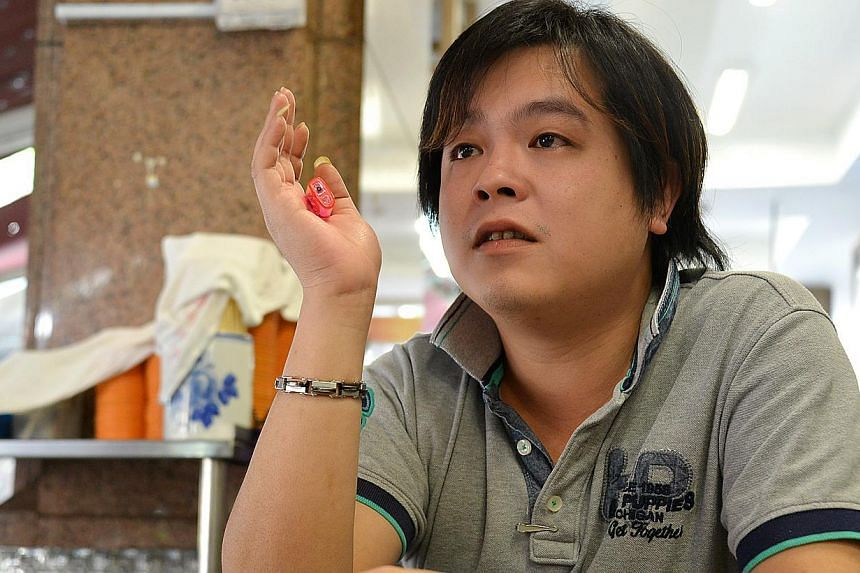 Jover Chew (above) and his shop became infamous after videos were posted last November of a crying Vietnamese tourist begging staff at the shop to refund his money. -- PHOTO: THE NEW PAPER FILE