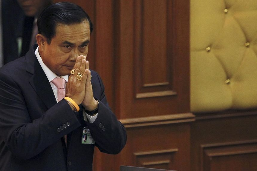Thailand's Prime Minister Prayuth Chan-o-cha gestures in a traditional greeting to National Legislative Assembly members at the parliament in Bangkok, Thailand, on May 21, 2015. -- PHOTO: REUTERS