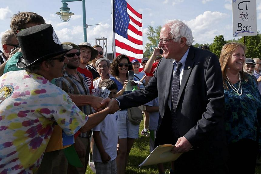 "Democratic presidential candidate Senator Bernie Sanders (right) greets supporters as he arrives at a ""hometown kickoff"" campaign event in Burlington, Vermont, on May 26, 2015. -- PHOTO: REUTERS"