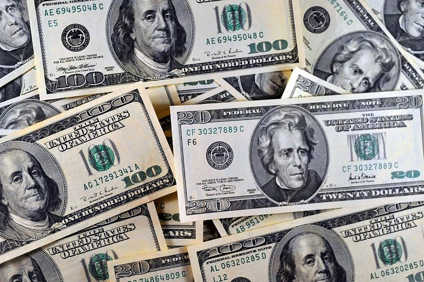 The US dollar jumped to an almost eight-year high against the yen as economic reports suggested the US is getting back on track after a slow first quarter. -- PHOTO: AFP