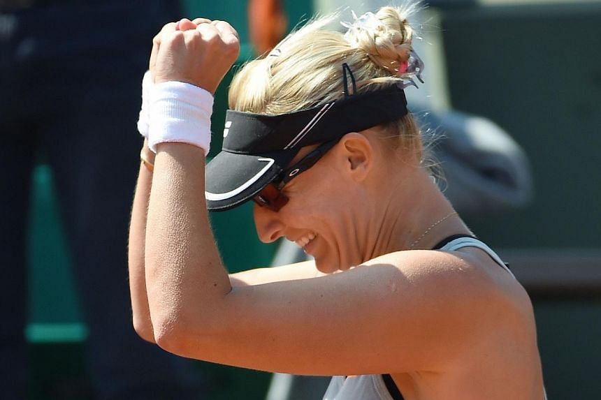 Croatia's Mirjana Lucic-Baroni celebrates after defeating Romania's Simona Halep during the women's second round at the Roland Garros 2015 French Tennis Open in Paris on May 27, 2015.-- PHOTO:AFP