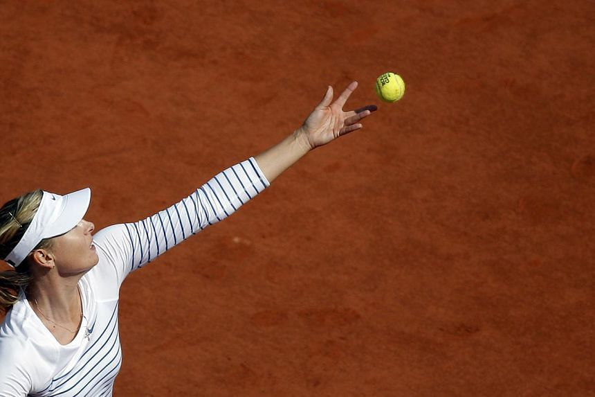 Maria Sharapova of Russia serves against Vitalia Diatchenko of Russia during their second round match for the French Open tennis tournament at Roland Garros in Paris, France on May 27, 2015. -- PHOTO: EPA