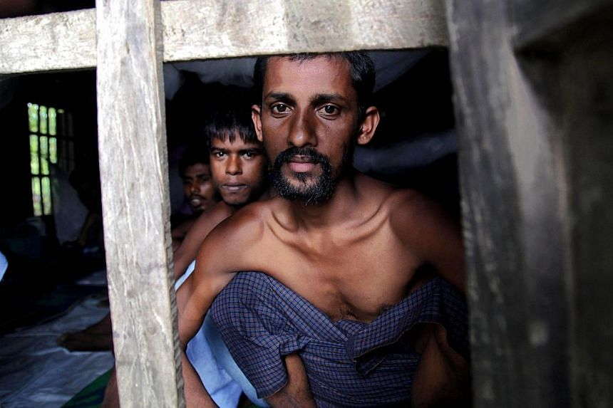 Rohingya Muslims from Bangladesh rescued by the Myanmar navy sit inside buildings at a temorary refugee camp in the village of Aletankyaw in the Maungdaw township of northern Rakhine state, Myanmar on May 23, 2015. Bangladesh on Wednesday, May 27, sa