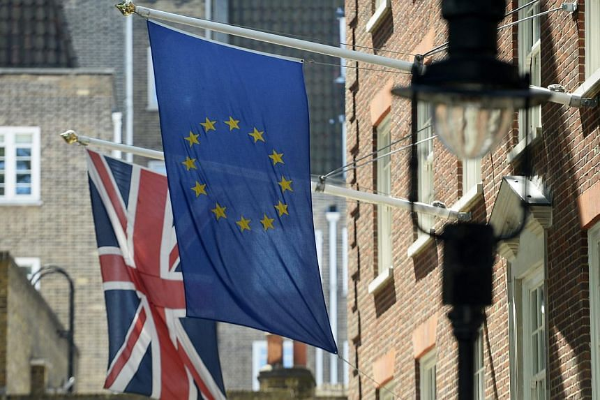 """The Union Flag (left) next to the EU flag (right) near Westminster in London, Britain on May 26, 2015. British voters will be asked to vote """"Yes"""" or """"No"""" on remaining in the European Union in a referendum to be held by the end of 2017, media reported"""