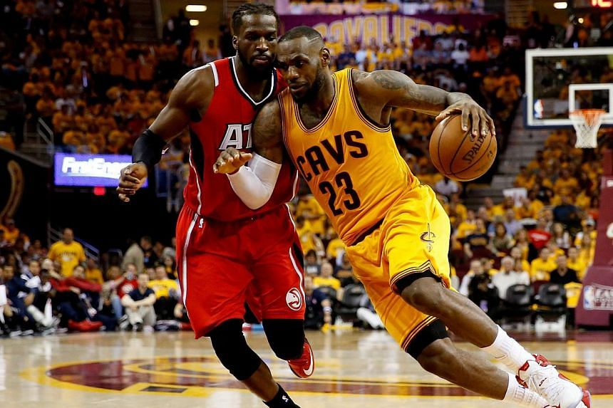 LeBron James (right) of the Cleveland Cavaliers drives with the ball against DeMarre Carroll (left) of the Atlanta Hawks in the third quarter during Game Four of the Eastern Conference Finals of the 2015 NBA Playoffs at Quicken Loans Arena on May 26,