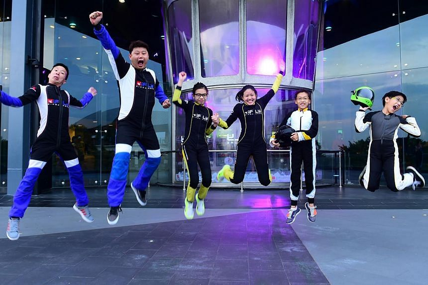 The iFly Singapore team consisting of (from left) Jonathan Loh, Lawrence Koh, Kyra Poh, Choo Yi Xuan, Lye Yu Xuan and Jordan Lee. The team broke five Guinness World Records on May 21, 2015. -- PHOTO: IFLY SINGAPORE
