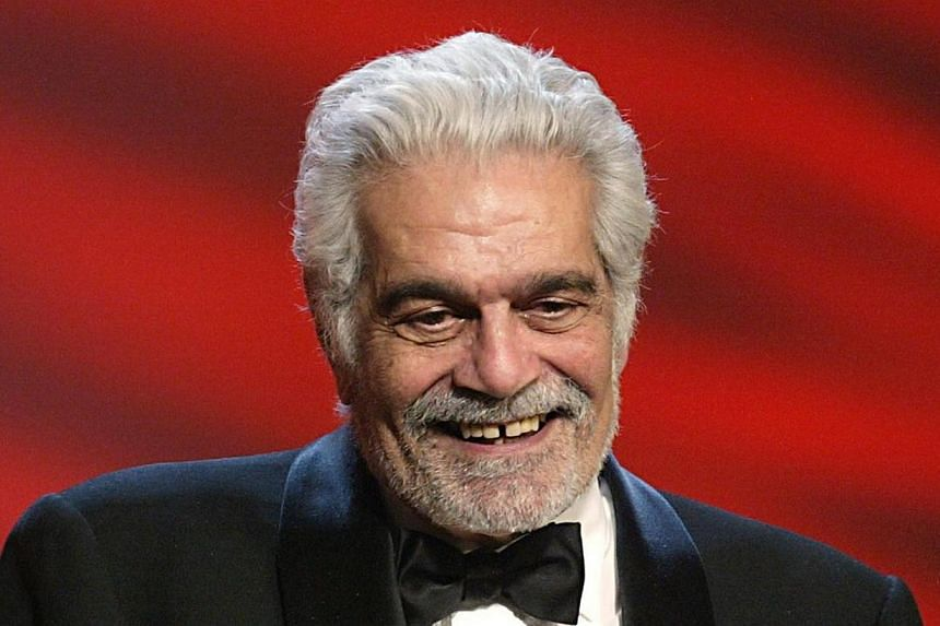 Egyptian born actor Omar Sharif smiles after being awarded as Best actor during the 29th Nuit des Cesars at the Chatelet theatre in Paris in this 2004 file photo. -- PHOTO: AFP