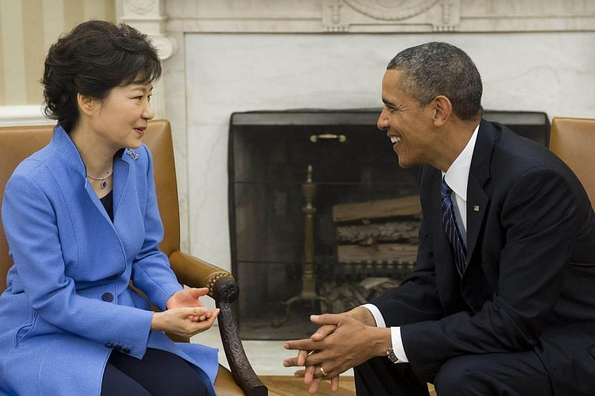 US President Barack Obama meets with South Korean President Park Geun-hye in the Oval Office of the White House in Washington, DC in this May 7, 2013 file photo. -- PHOTO: AFP