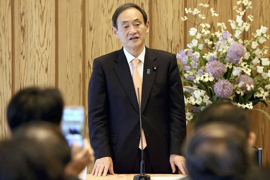 Chief Cabinet Secretary Yoshihide Suga makes remarks at the beginning of an interview with editors and publishers from the Asia News Network at the Prime Minister's Office in Chiyoda Ward, Tokyo, on Friday. -- PHOTO: THE YOMIURI SHIMBUN