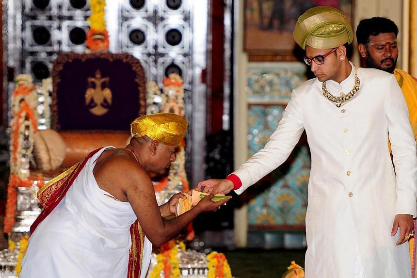 An Indian priest performing rituals during a coronation ceremony for the royal orient Yaduveer Krishnadatta Chamaraja Wadiyar at Amba Vilas Palace in Mysore, India on May 28, 2015. -- PHOTO: EPA