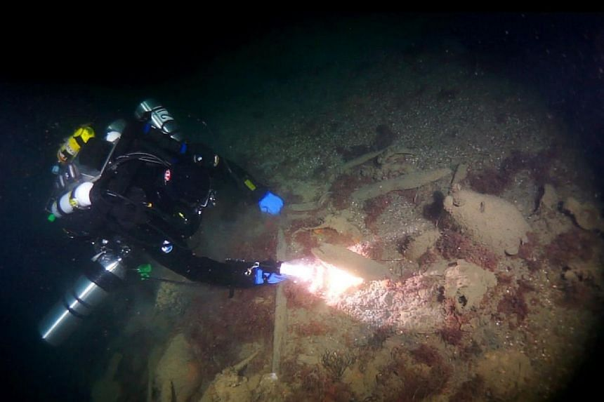 An undated handout picture released by Russia's Rostov Dive divers club shows a diver observing ancient amphoras at the site of a Byzantine shipwreck off the city of Sevastopol. -- PHOTO: AFP/ RUSSIA'S ROSTOV DIVE DIVERS CLUB