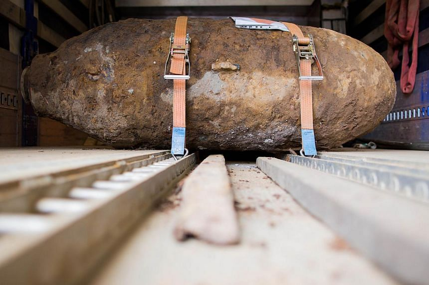 Disarmed World War II bomb is pictured on the platform of a truck near Muehlheim Bridge in Cologne, western Germany, on May 27, 2015. -- PHOTO: AFP
