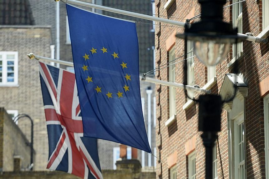 """The Union Flag (left) next to the EU flag (right) near Westminster in London, Britain, on May 26, 2015.Voters will be asked """"Should the United Kingdom remain a member of the European Union?"""" in a referendum to be held by 2017, the British gover"""