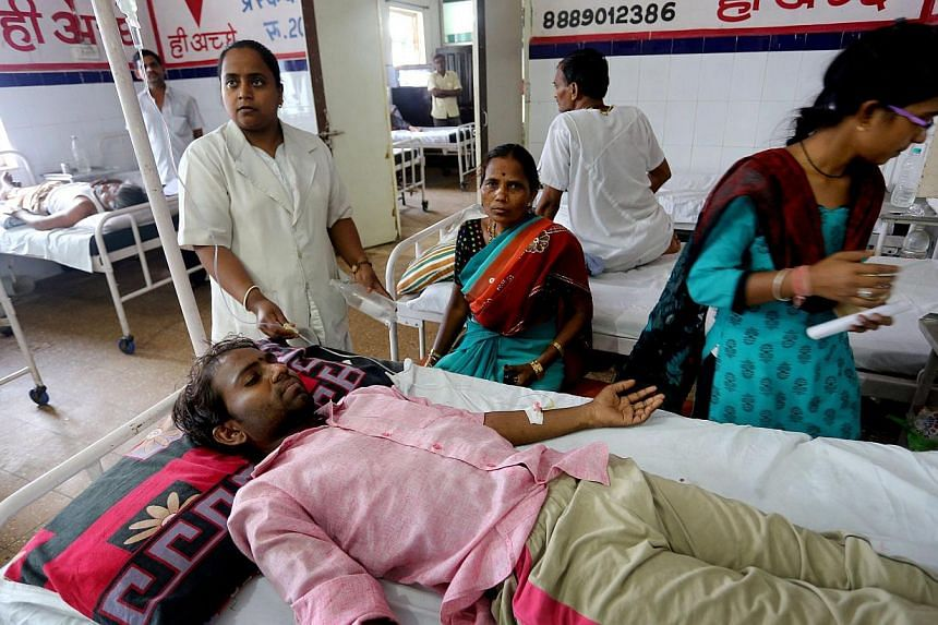 Sunil, 30, gets medical treatment in Jai Prakash Narayan hospital after suffering sunstroke and severe dehydration in Bhopal Madhya Pradesh, India on May 27,2015. Hospitals in India were struggling on Thursday to cope with an influx of victims
