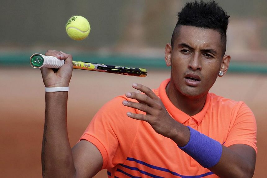 Australia's Nick Kyrgios reacting during his match against Uzbekistan's Denis Istomin during the men's first round of the Roland Garros 2015 French Tennis Open in Paris on May 25, 2015. -- PHOTO: AFP