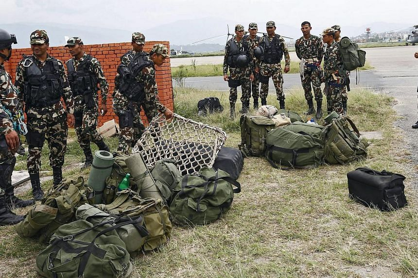 Nepal Army special force preparing to search for debris of the US helicopter that crashed on May 15, 2015. -- PHOTO: EPA