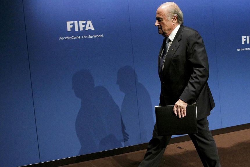 "Fifa President Sepp Blatter leaving after a news conference at the Fifa headquarters in Zurich in this May 30, 2011, file picture. Blatter admitted football's world body faces a ""difficult time"" because of a major corruption storm but vowed any offic"