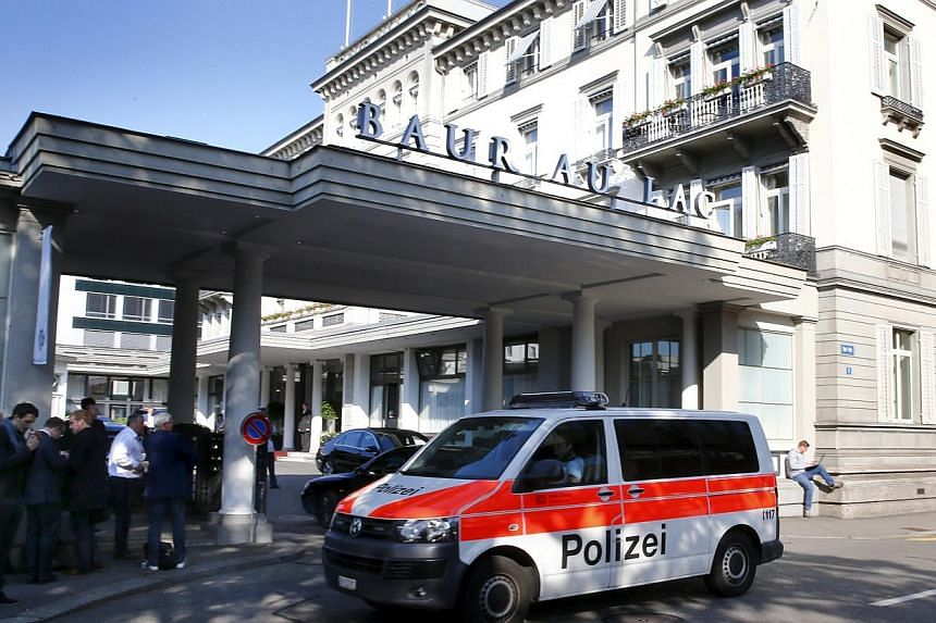 A police van drives past the Baur au Lac hotel in Zurich yesterday, when seven Fifa officials were arrested and detained pending extradition to the United States. The early-morning raids related to suspected corruption within soccer's governing body,