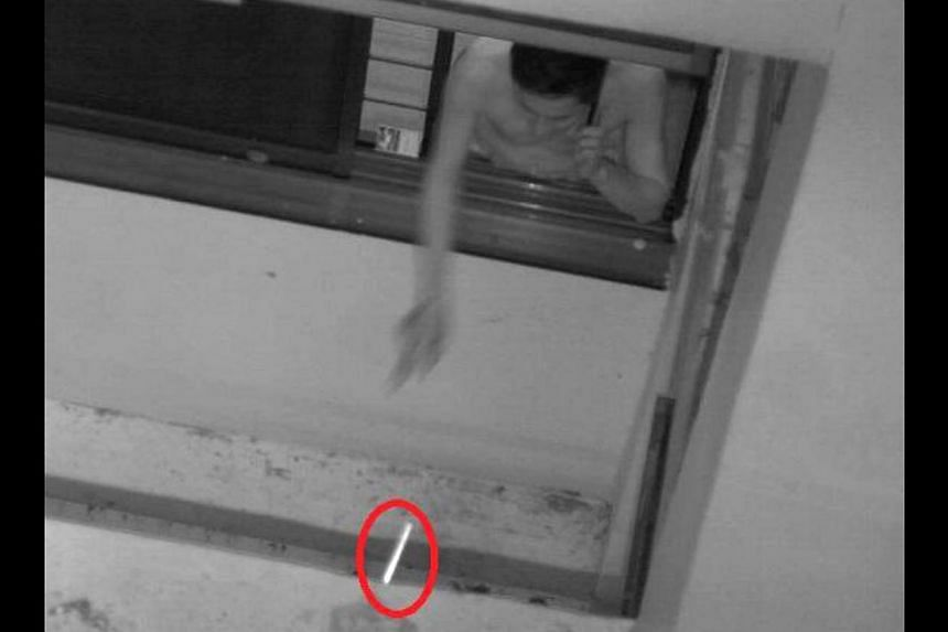 A man caught on camera throwing a cigarette butt out of the window at his home in Sengkang in January this year. According to tender documents, the new cameras will be deployed temporarily to monitor certain flats.