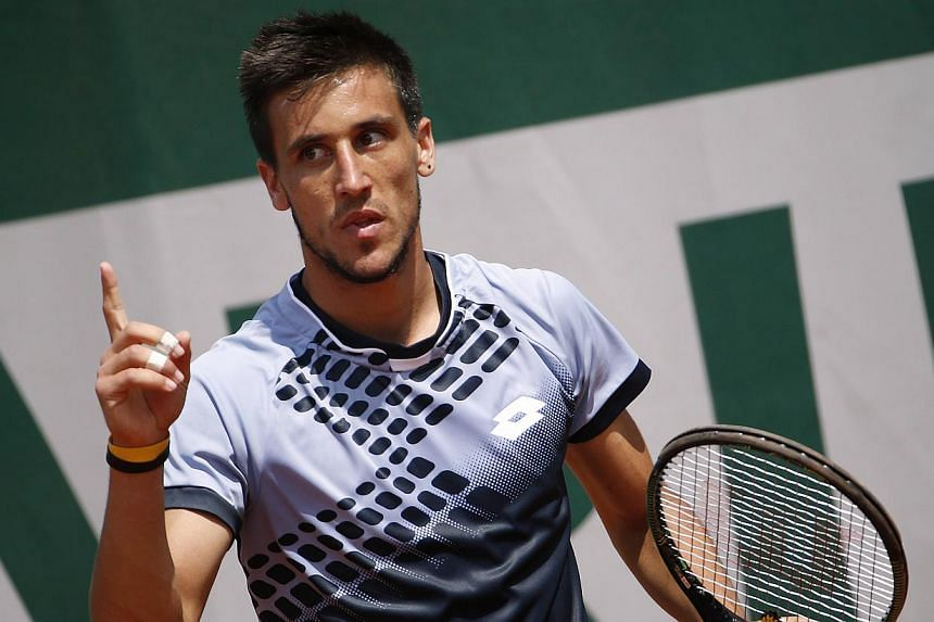 Bosnia-Herzegovina's Damir Dzumhur celebrating after winning a point against Cyprus' Marcos Baghdatis during the men's second round of the Roland Garros 2015 French Tennis Open in Paris on May 27, 2015. -- PHOTO: AFP
