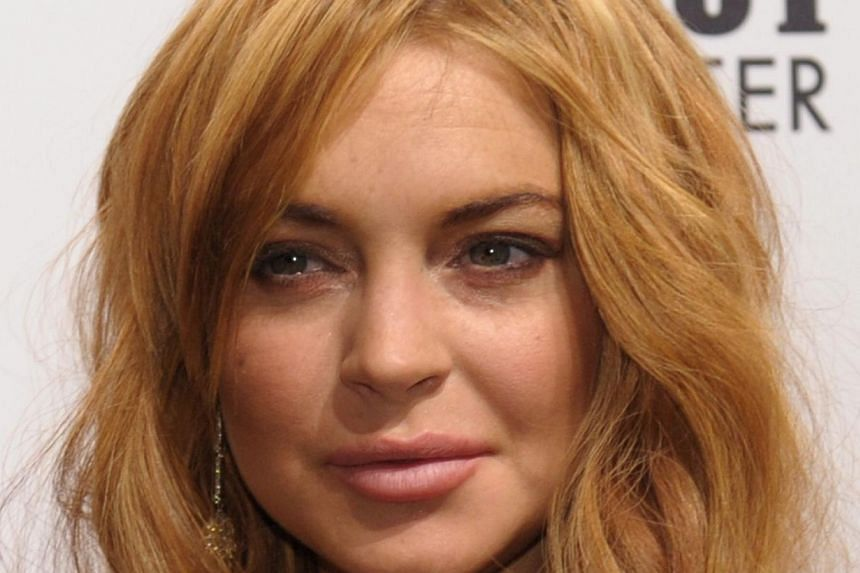 This February 6, 2013 file photograph shows Lindsay Lohan at the amfAR (The Foundation for AIDS Research) gala in New York. -- PHOTO: AFP