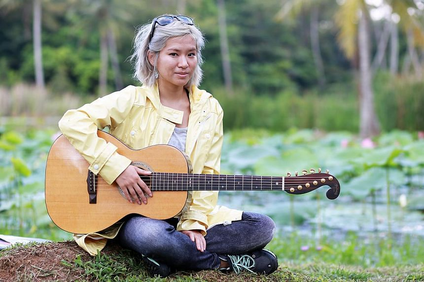 Singer- songwriter Inch Chua has been staying at a kampung on Pulau Ubin to find inspiration for her new songs. -- ST PHOTO: DANIEL NEO