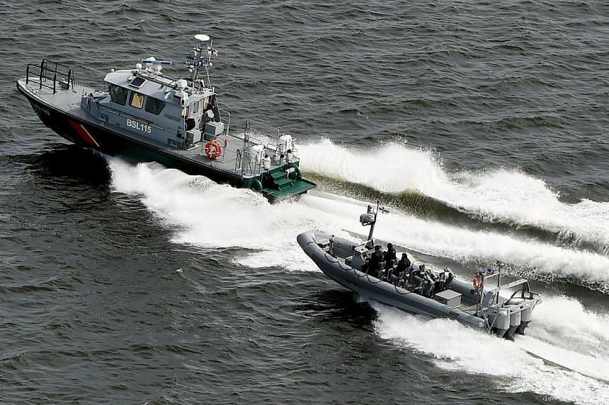 Finnish Border Guard boats patrol the waters near Helsinki on April 28, 2015.The Finnish Border Guard said on Thursday, May 28, that it had not been able to confirm the presence of a suspected submarine near Helsinki last month. -- PHOTO: REUTE