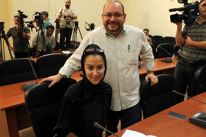 A file picture dated Sept 10, 2013, shows Washington Post Iranian-American journalist Jason Rezaian and his Iranian wife Yeganeh Salehi during a press conference in Teheran, Iran. -- PHOTO: EPA