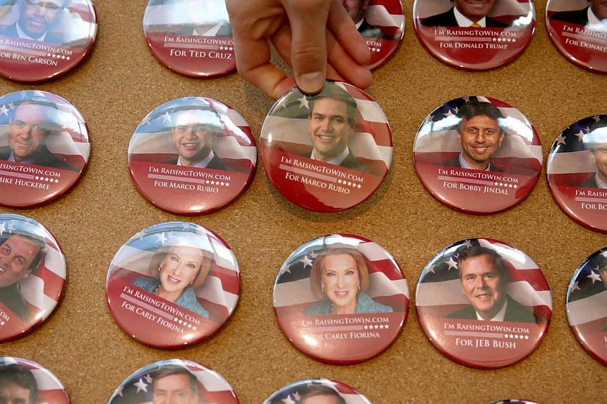 Campaign buttons featuring Republican presidential hopefuls are seen on display during the 2015 Southern Republican Leadership Conference on May 21, 2015 in Oklahoma City, Oklahoma. -- PHOTO: AFP
