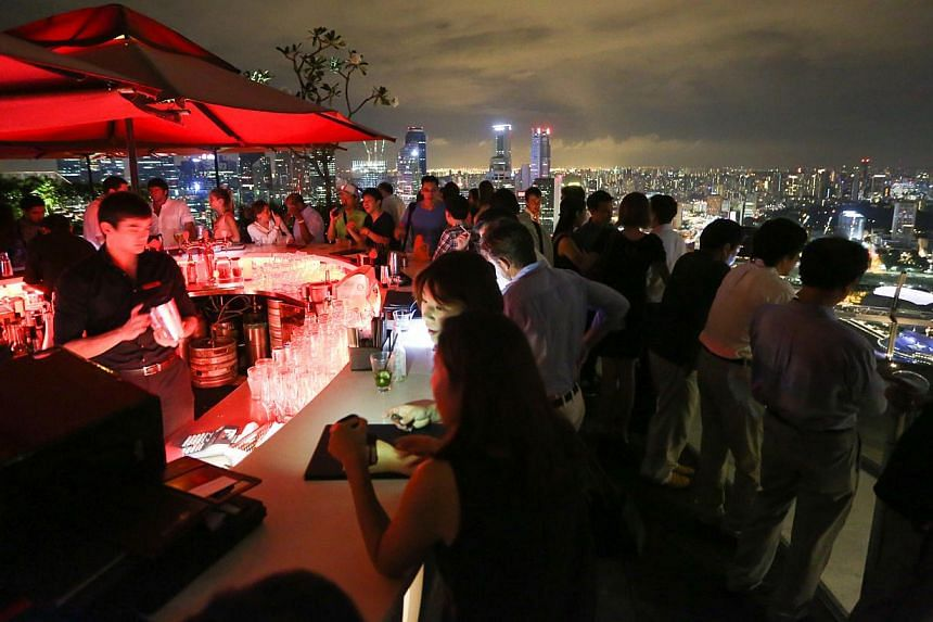 One of the biggest nightclub draws here, the 57th-floor bar on top of MBS has two weeks to undertake to the Court of Appeal that it will stop using the name. If not, the court will issue an order to stop its use. -- PHOTO: ST FILE
