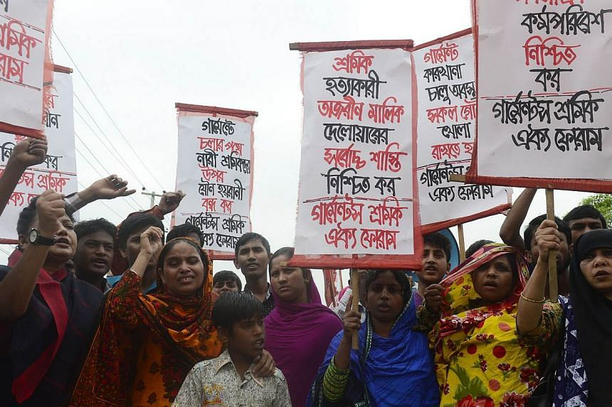 Memebers of the Bangladeshi garments worker union shout slogans as they mark the second anniversary of the Rana Plaza building collapse at the site where the building once stood in Savar, on the outskirts of Dhaka, on April 24, 2015.Two garment