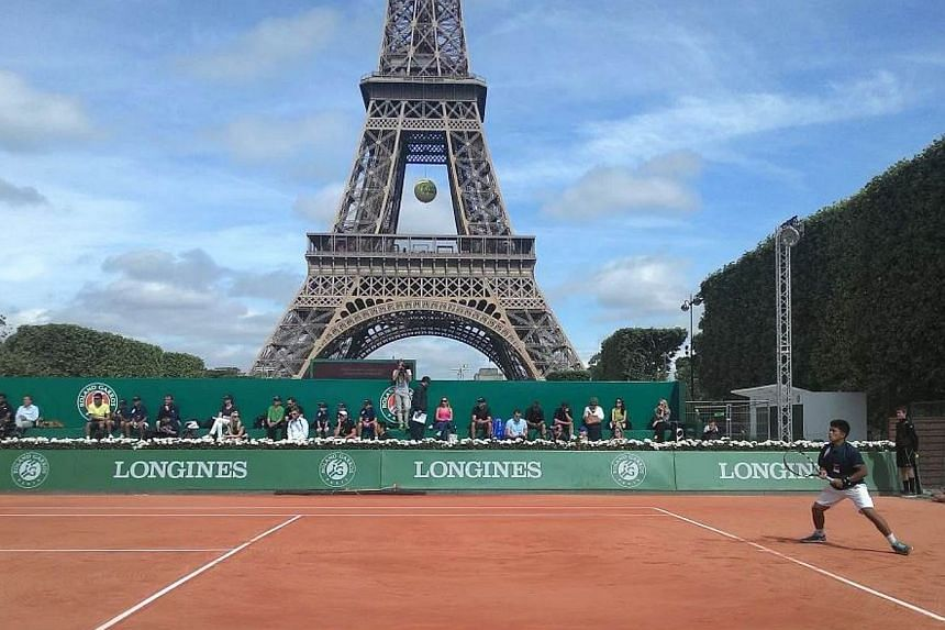 Ahmad Naqib, 12, in action at the Longines Future Tennis Aces tournament in Paris. -- ST PHOTO: DARYL CHIN