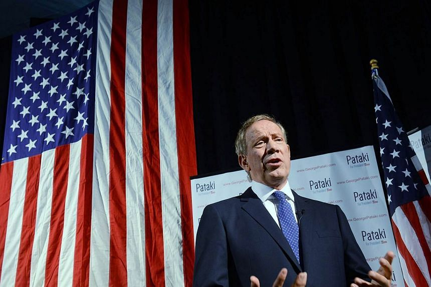 Former New York Gov. George Pataki is interviewed by the media prior to announcing his candidacy for the 2016 Republican presidential nomination on May 28, 2015 in Exeter, New Hampshire. -- PHOTO: AFP