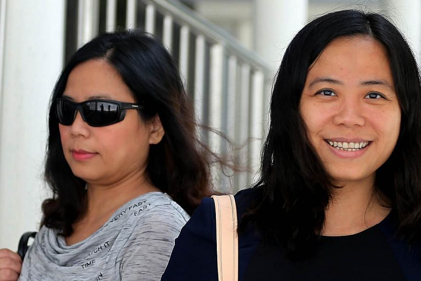 Tang Bei (left) was charged in court on Thursday with assaulting a condominium manager and spitting on him. Her twin sister, Tang Lei (right), had earlier been charged. -- ST PHOTO: WONG KWAI CHOW